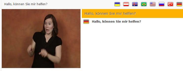 """Screenshot von Spread Signs: Frau gebärdet """"Hallo, können Sie mir helfen?"""""""